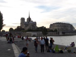 dancing with Notre Dame in background