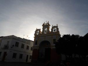 church in Zahara de la Sierra in the town square as the sun is setting